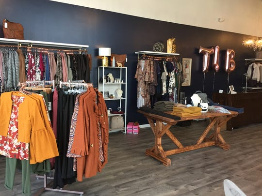 A peek inside Three Little Birds Boutique, a trendy women's fashion store at Hershey Towne Square.