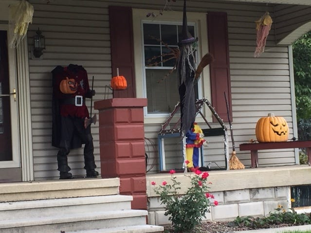 In addition to a headless man, there's a flying witch and a creepy clown on this porch on Main Street, Myerstown.