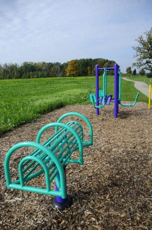 A waist stretcher and a leg press are part of the equipment installed at the Diamond Trail in Sandusky.