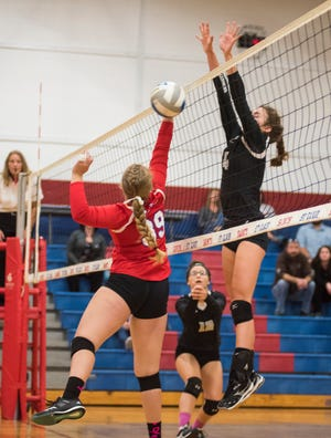 Marine City High School's Elizabeth Coverdill (4) jumps to block a shot by St. Clair's Lauren Rozelle during their game Thursday, Oct. 11, 2018 at St. Clair High School.