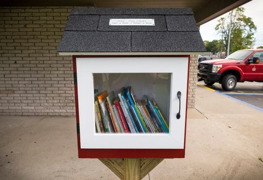 A free library sits full of books after being installed Thursday, Oct. 11, 2018 at Gratiot Village in Port Huron. For the Port Huron Housing Commission's 50th anniversary, its staff has built free libraries that will be installed at each of its family apartments in Port Huron.