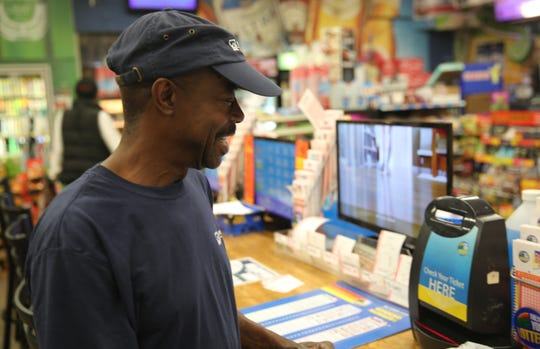 Harry Thrower scans his lottery tickets on Thursday at Thrifty Beverage in the City of Poughkeepsie. He buys lottery tickets almost every day and said he plans on buying a ticket for the Mega Millions on Friday.