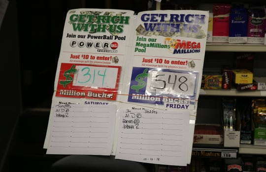 A sign in Thrifty Beverage in the City of Poughkeepsie shows the jackpot for the Mega Millions in New York, which had reached $548 million as of Thursday afternoon. Store management said they expect people who wouldn't normally participate in the lottery to buy tickets.