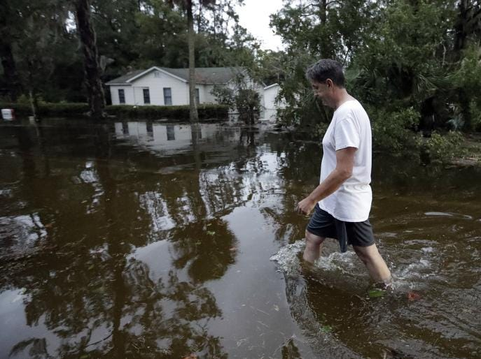 John Gouge walks through flood waters as he goes to check on the post office Wednesday, Oct. 10, 2018, in St. Marks, Fla. Supercharged by abnormally warm waters in the Gulf of Mexico, Hurricane Michael slammed into the Florida Panhandle with terrifying winds of 155 mph Wednesday, splintering homes and submerging neighborhoods before continuing its march inland. (AP Photo/Chris O'Meara)