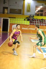 Dallastown graduate Four McGlynn dribbles in a game for Illiabum Clube of the Portugal Basketball League on Sunday, Oct. 7.