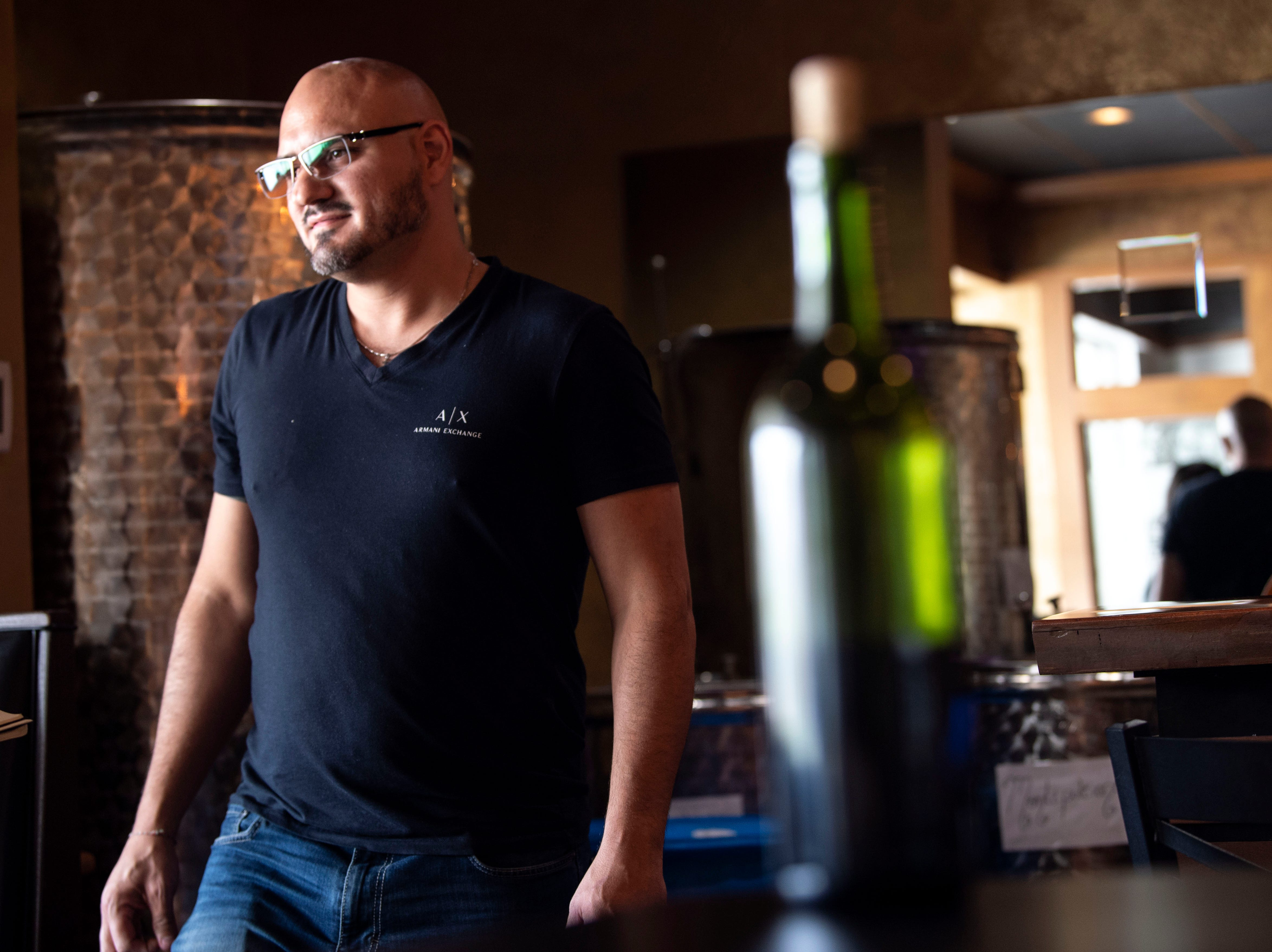 Vito Serradella, co-owner of the Wood Fire Italian Grill started making wine with his grandfather in Italy. It was a passion for his family, and now he brings that passion to his restaurant, Wednesday, Oct. 10, 2018. The restaurant, which opened at the beginning of this year, has added on a bar, where they make their own wine to serve.
