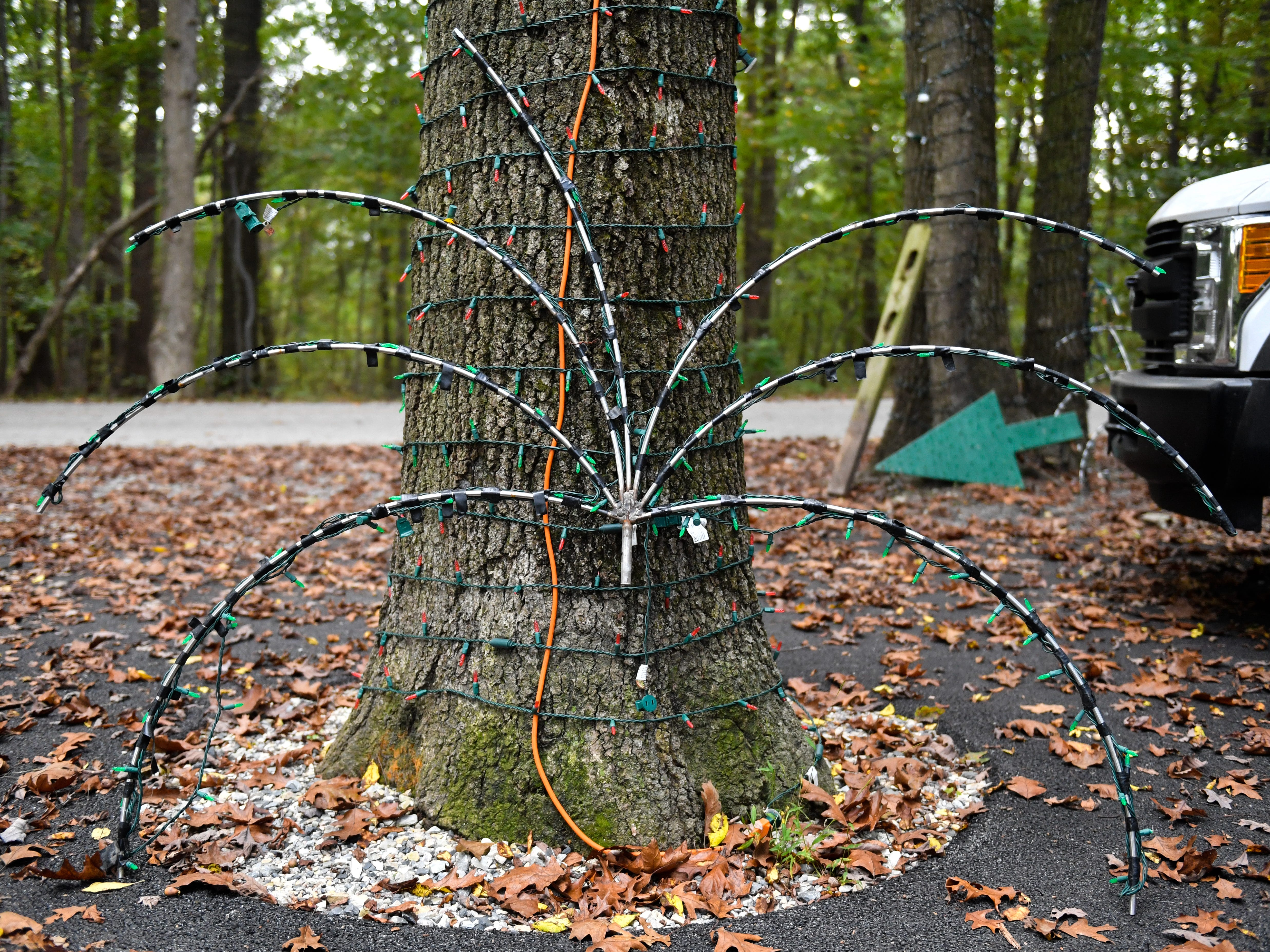 Lights waiting to put up are sat next to the trees they'll go on at Christmas Magic in Rocky Ridge County Park, October 10, 2018.
