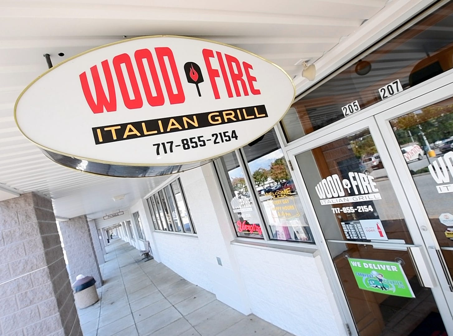 Wood Fire Italian Grill, on Pauline Drive, which opened at the beginning of this year, has added on a bar, where they make their own wine to serve.
