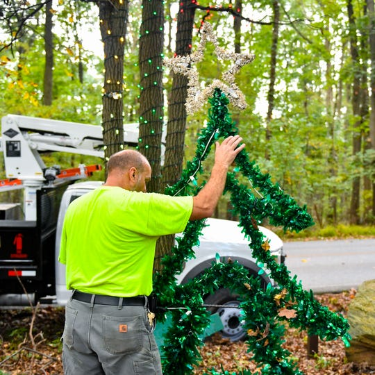Decorations are being raised into the trees as crews prep for a new season of Christmas Magic at Rocky Ridge County Park. New this year is a timed ticket plan for weekend visitors.