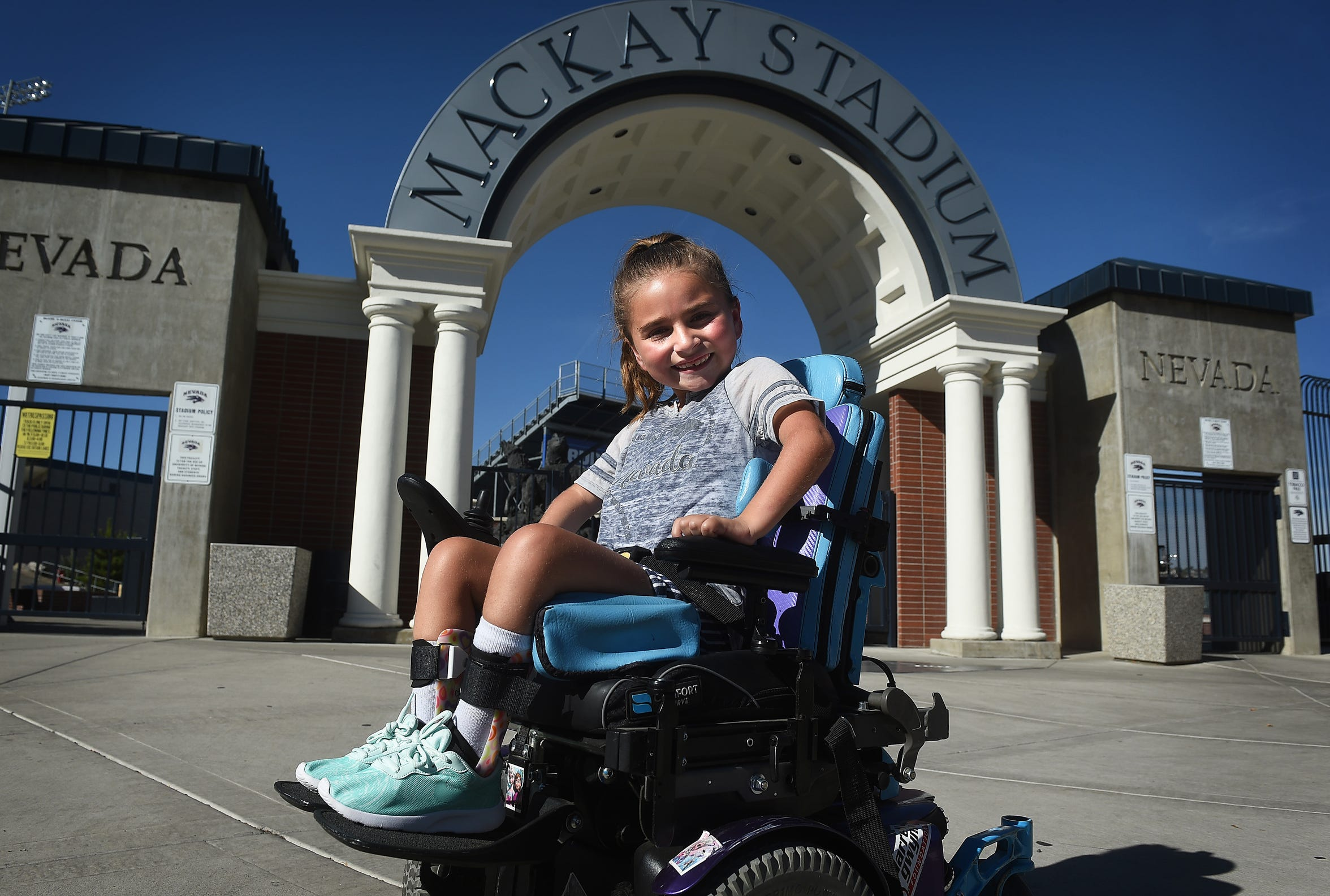 Seven year old Ella Marini poses for a portrait in front of Mackay Stadium in Reno on Sept. 29, 2018.