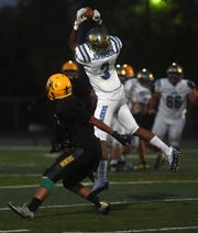 Reed's Demarea Johnson-Cooper (3) makes a catch against Bishop Manogue during their football game in Reno on Aug. 24.