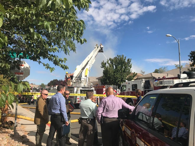 Crews on the scene of a house fire on Dolce Drive in Sparks on Thursday, Oct. 11, 2018.