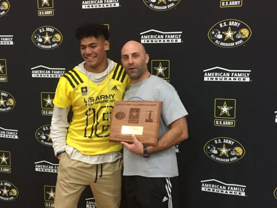 Brandon Kaho and Reno football coach Dan Avansino at the ceremony for Kaho's invitation to play in the U.S. Army All-America Bowl last year.