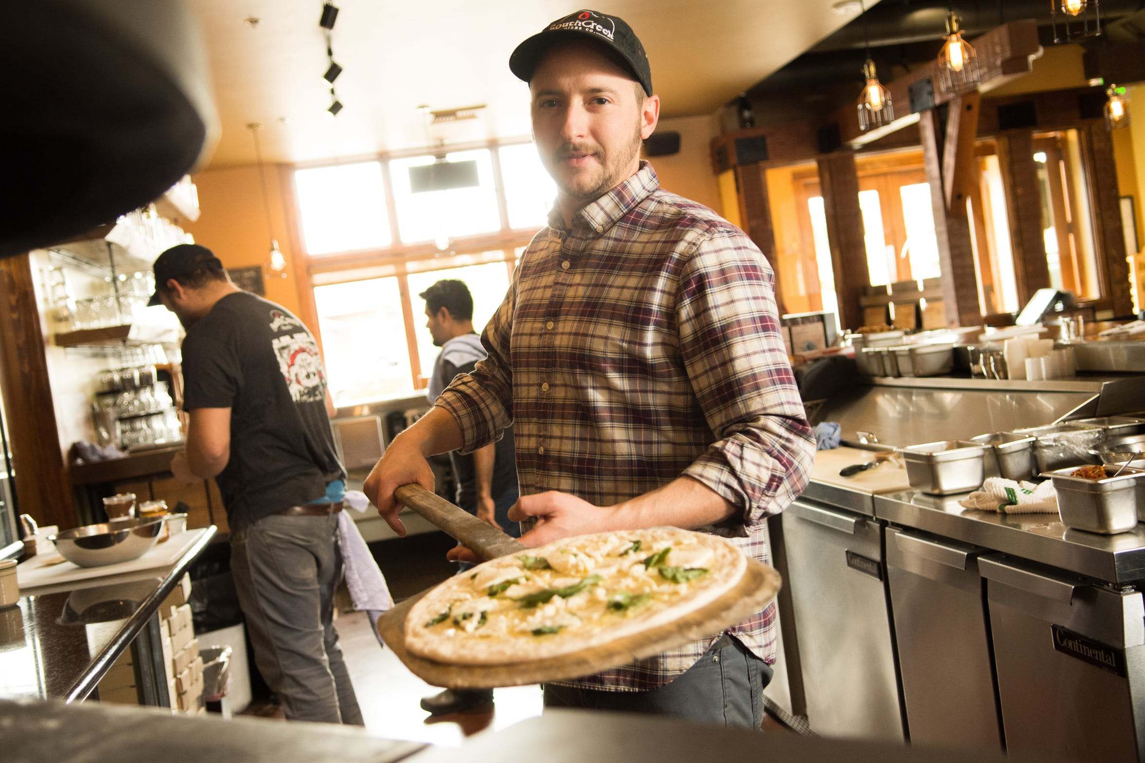 Ian Madan, pizzaiolo at SouthCreek Pizza Co., a restaurant offering a beer, wine and pizza special (including a cheese steak version) for Reno Bites 2018.