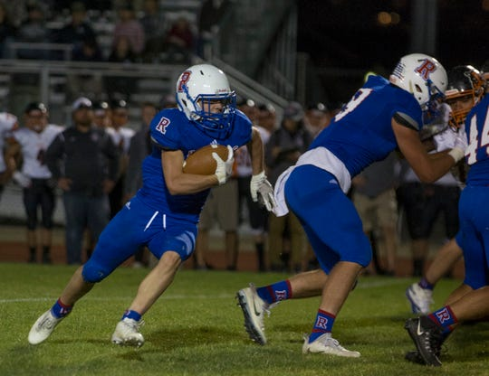Reno's Drue Worthen runs against Douglas in their football game at Reno High School on Sept. 14, 2018.
