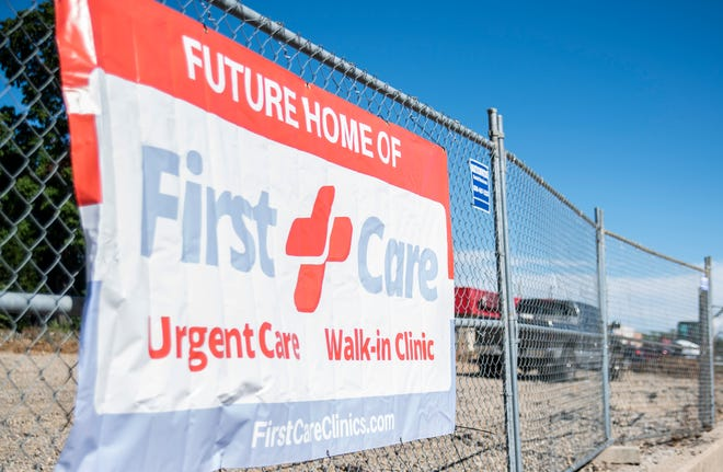 A sign for the under-construction First Care urgent care clinic is seen along East Main Street, Richmond, on Thursday, Oct. 11, 2018.