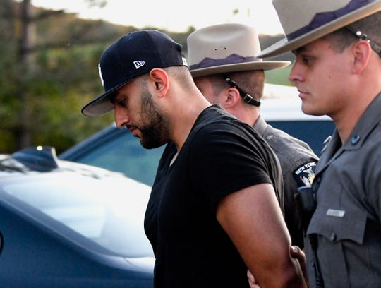 Nauman Hussain is brought into Cobleskill Town, N.Y., court for arraignment Wednesday, Oct. 10, 2018. Limousine service operator, Hussain, was charged Wednesday with criminally negligent homicide in a crash that killed 20 people, while police continued investigating what caused the wreck and whether anyone else will face charges.
