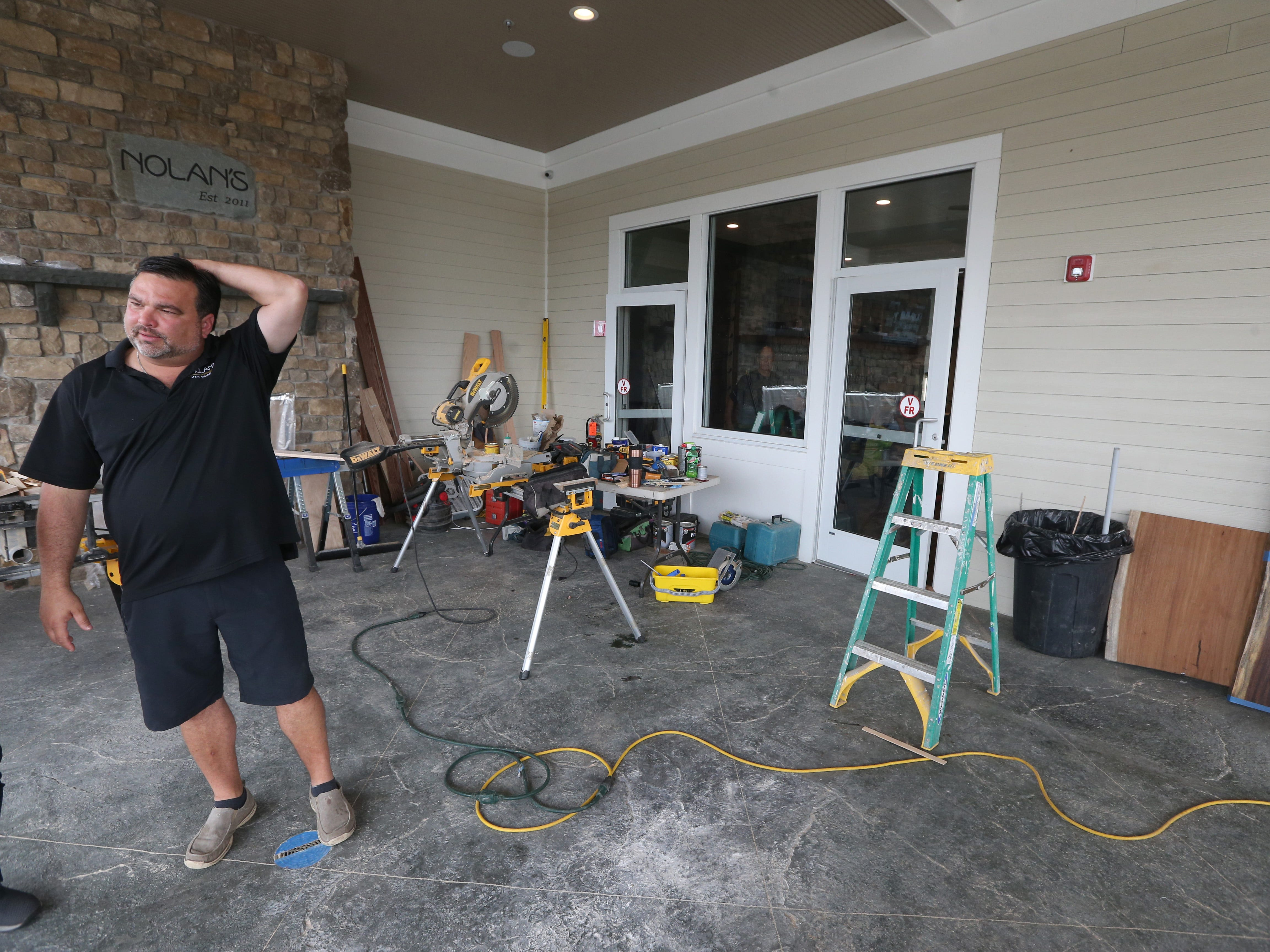 Nick Violas on the outside deck area at Nolan's in Canandaigua.  The deck is being built exactly where the old deck was before the fire on July 13, 2017.
