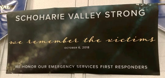 A sign Wednesday, Oct. 10, 2018, at a vigil in Schoharie honors the victims of a limo crash there days ago that killed 20 people.