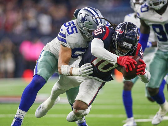 Houston Texans wide receiver DeAndre Hopkins (10) runs with the ball after a reception during overtime as Dallas Cowboys linebacker Leighton Vander Esch (55) attempts to make a tackle at NRG Stadium.
