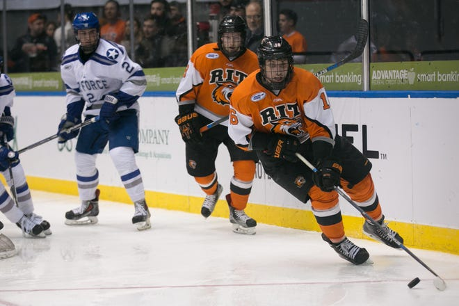 RIT forward Erik Brown skates with the puck during the Atlantic Hockey semifinal against Air Force at the Blue Cross Arena at the War Memorial in Rochester on Friday, March 18, 2016. Brown, now a senior, scored 29 goals last season.