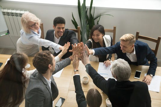 Diverse Business Team Giving High Five Showing Unity Top View