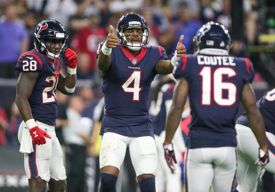 Houston Texans quarterback Deshaun Watson (4) motions to the sideline.