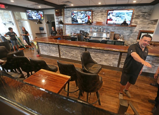 Nick Violas, owner of Nolan's, talks about putting in a new seating area set up from the bar area at Nolan's in Canandaigua Thursday, Oct. 11, 2018.