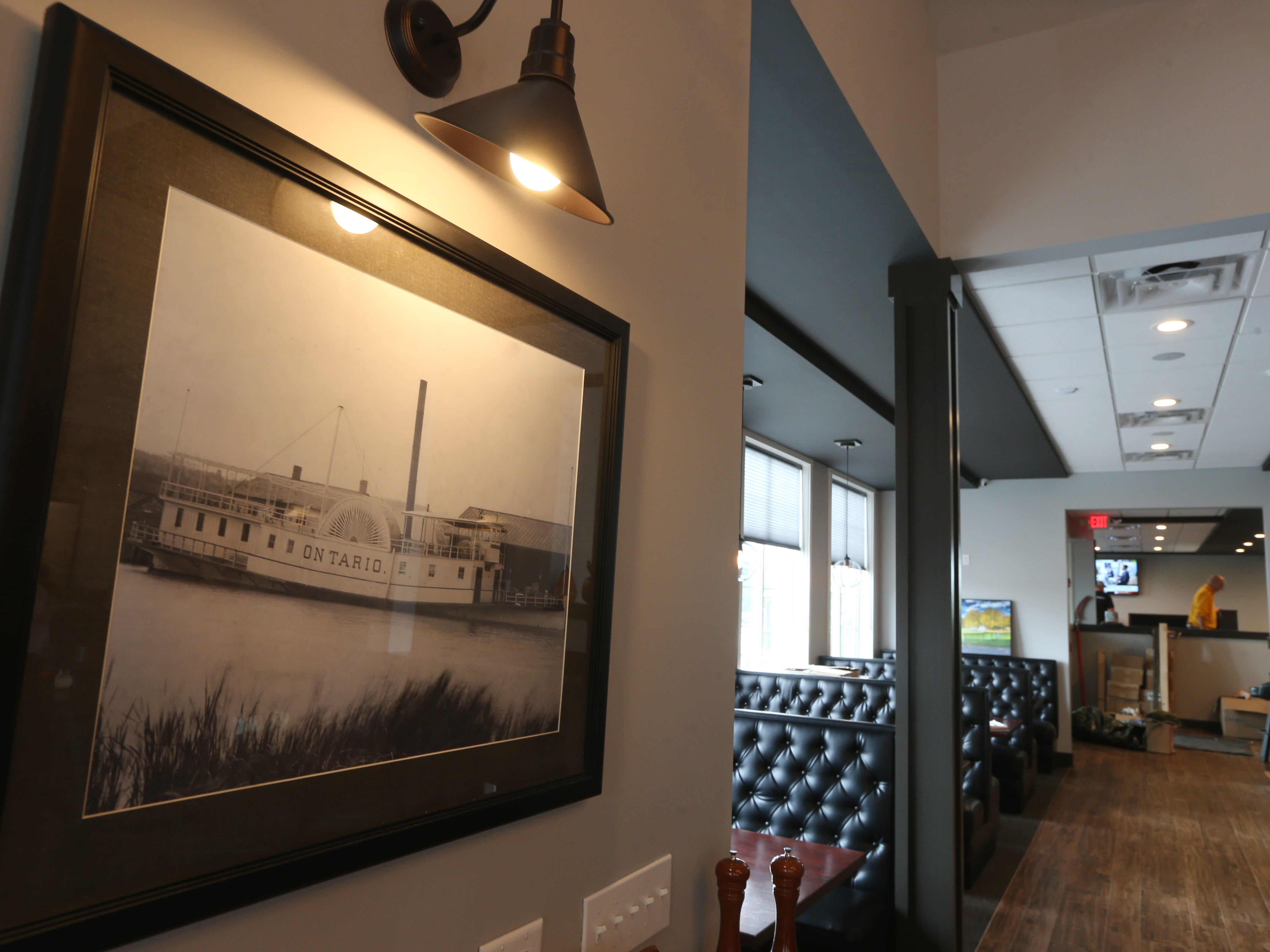 A photo of the steamboat Ontario hangs in the dining room at Nolan's.  The photo was one of the few items saved from the original Nolan's that was destroyed in a fire on July 13, 2017.