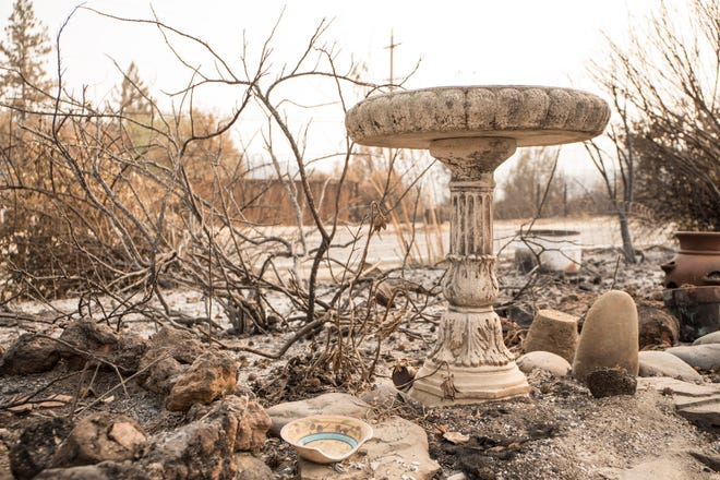 A birdbath remains among the ashes of a home on Keswick Rd. near Tanstaafl Lane lost to the Carr fire in Keswick, Calif., Saturday, August 26, 2018.