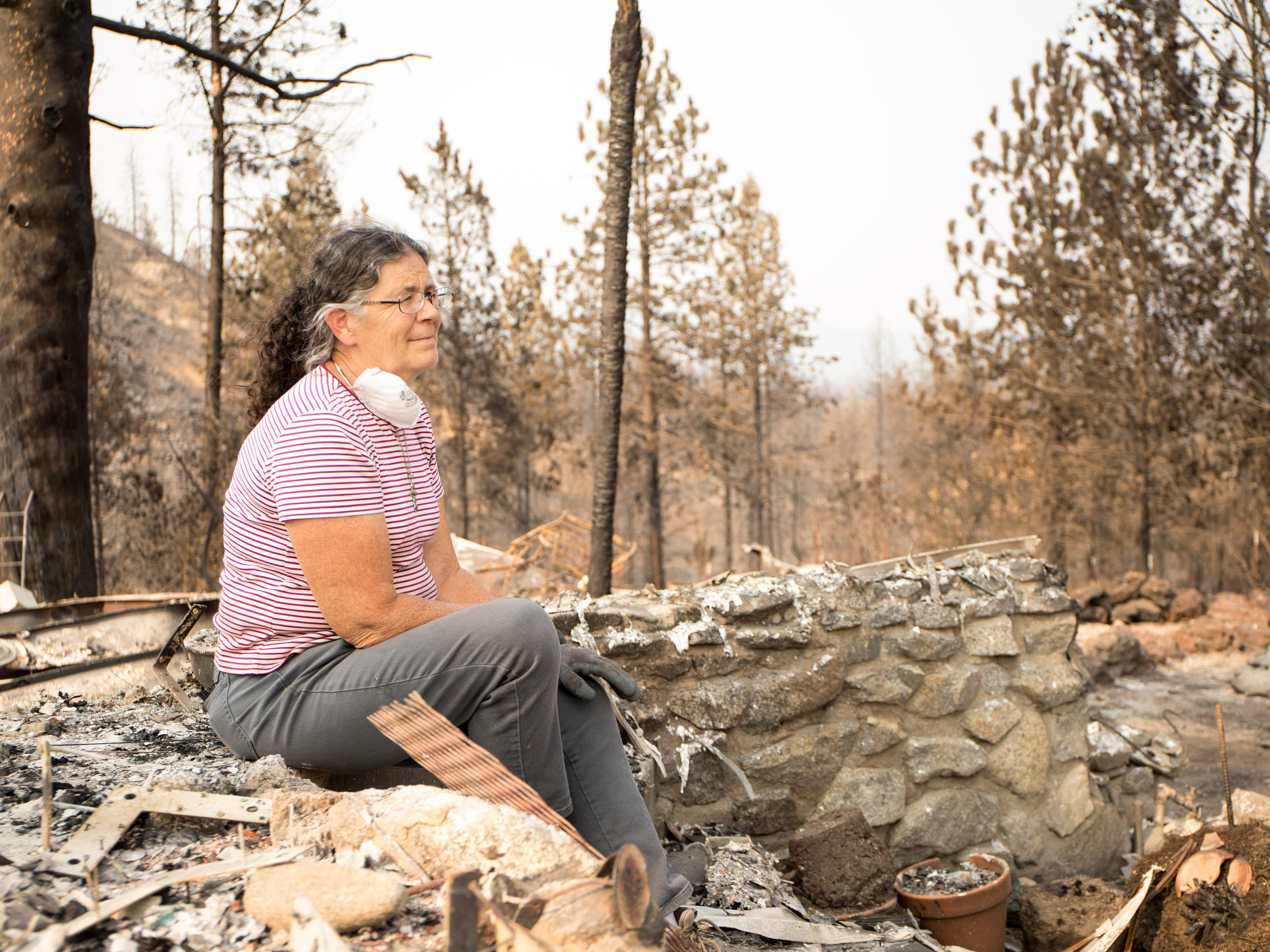 Marci Fernandes, 62 lost her home on Keswick Rd. near Tanstaafl Lane in the Carr fire in Keswick, Calif., Saturday, August 26, 2018.