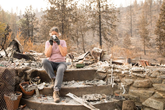 Marci Fernandes, 62, gearing up to search through the ashes of the remains of her home following the Carr Fire in August. The property was later was cleared of debris. Fernandes plans to rebuild.