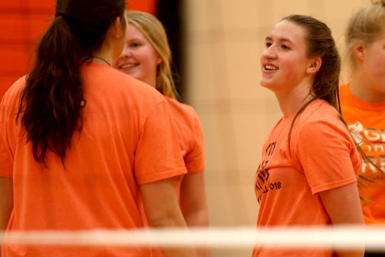 Senior outside hitter Morgan Doll smiles with teammates during a volleyball practice at Sprague High School in Salem on Wednesday, Oct. 10, 2018.