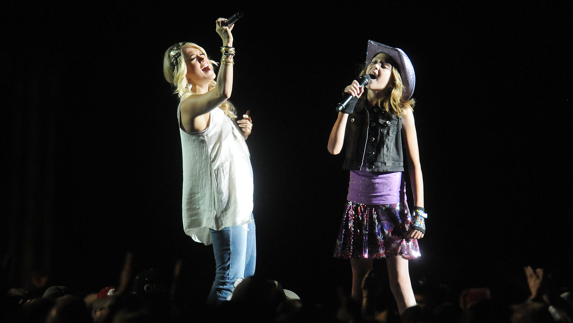 """The Willamette Country Music Festival is in financial difficulty. Pictured , Country music star Carrie Underwood sings """"All American Girl"""" with Kaitlyn Finn, 10, of Damascus."""