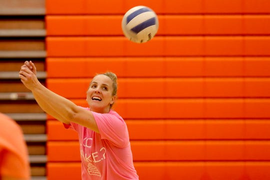 Sprague volleyball coach Anne Olsen participates with players during a practice at Sprague High School in Salem on Wednesday, Oct. 10, 2018.