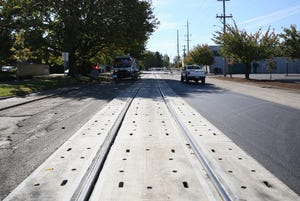 Train track construction on Front Street NE, north of downtown, is shown on Thursday, Oct. 11, 2018.