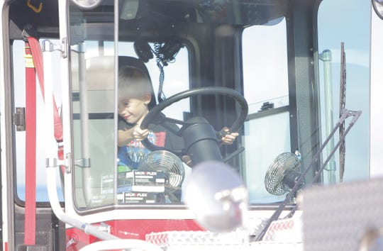 Patrick Furey, 6, sits in the rear cab of a Salinas Fire Department ladder truck Wednesday during the department's open house.