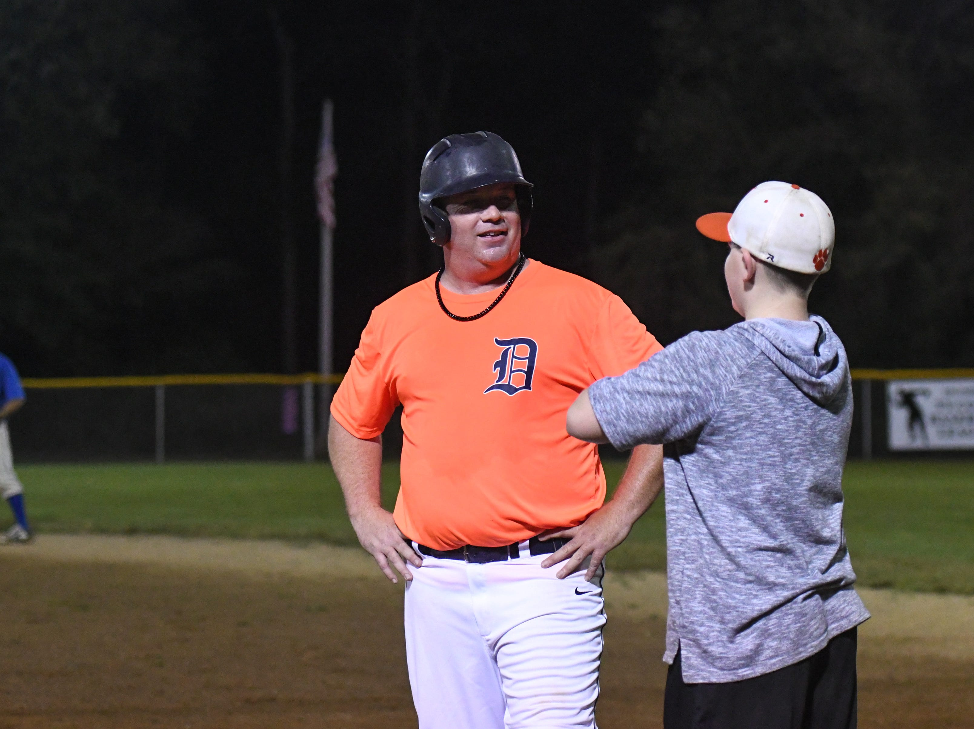 Jerry Pierson gets advice from son and first base coach Tucker Pierson during a game in the new Ty Cobb Senior Baseball League in Salisbury on Tuesday, Oct 9, 2018.