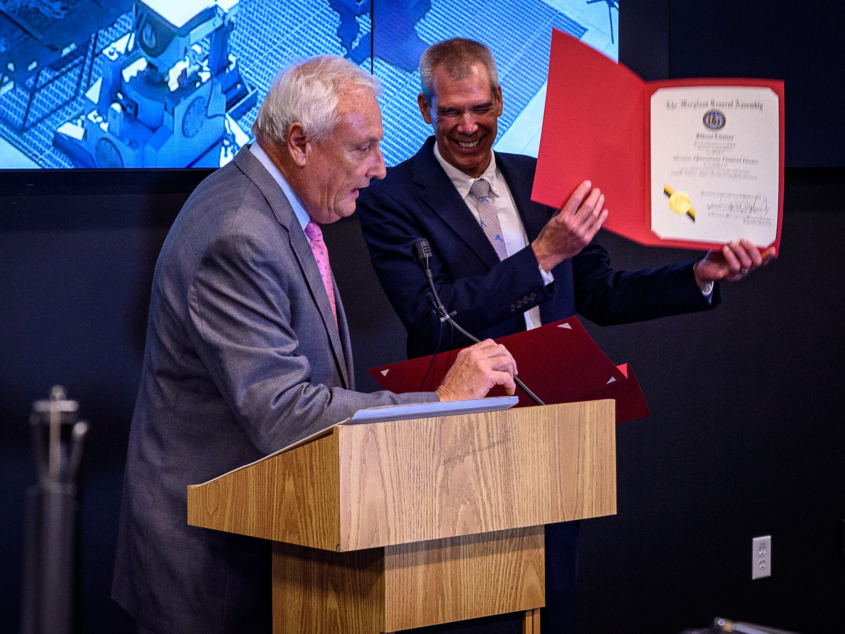 Maryland State Sen. Jim Mathias  presents a proclamation to Bill Wrobel, director of Wallops Flight Facility, at the  ribbon-cutting of the new command center and fire station at Wallops.