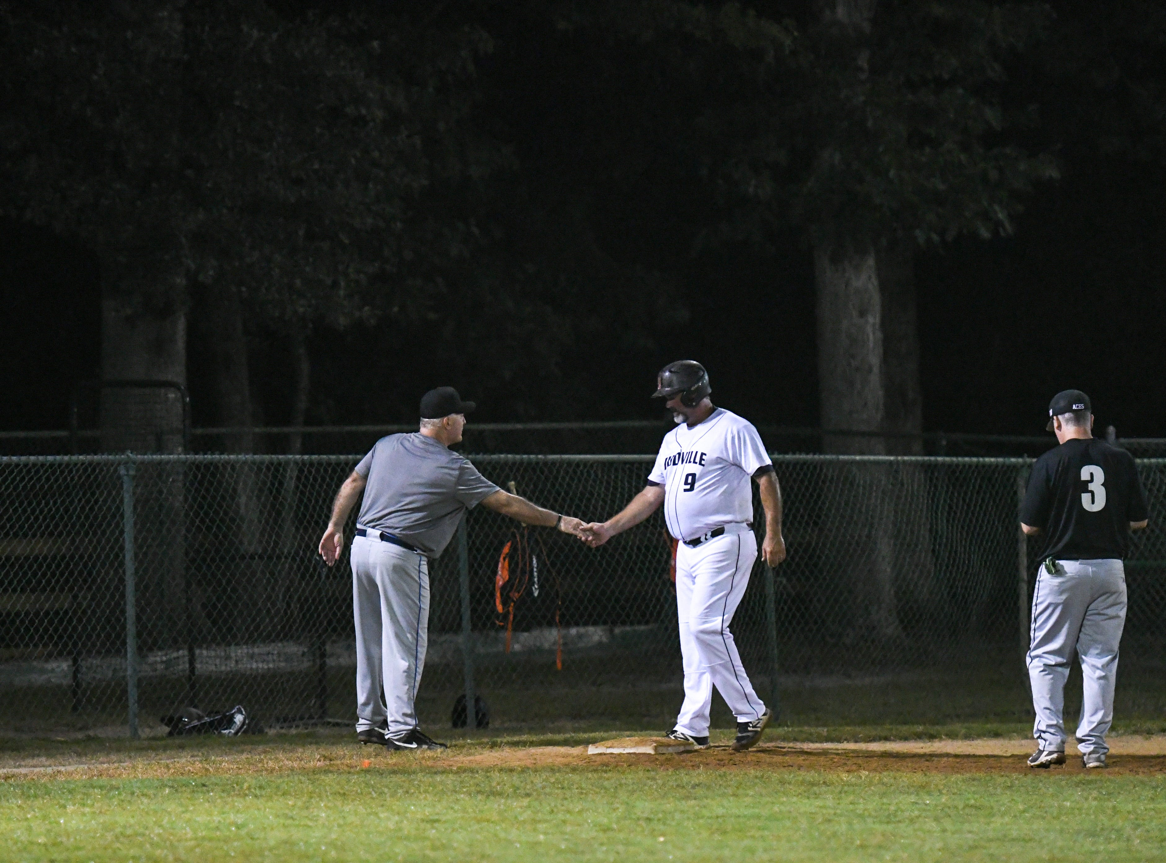 Eric Lauer makes it to third base during a game in the new Ty Cobb Senior Baseball League in Salisbury on Tuesday, Oct 9, 2018.