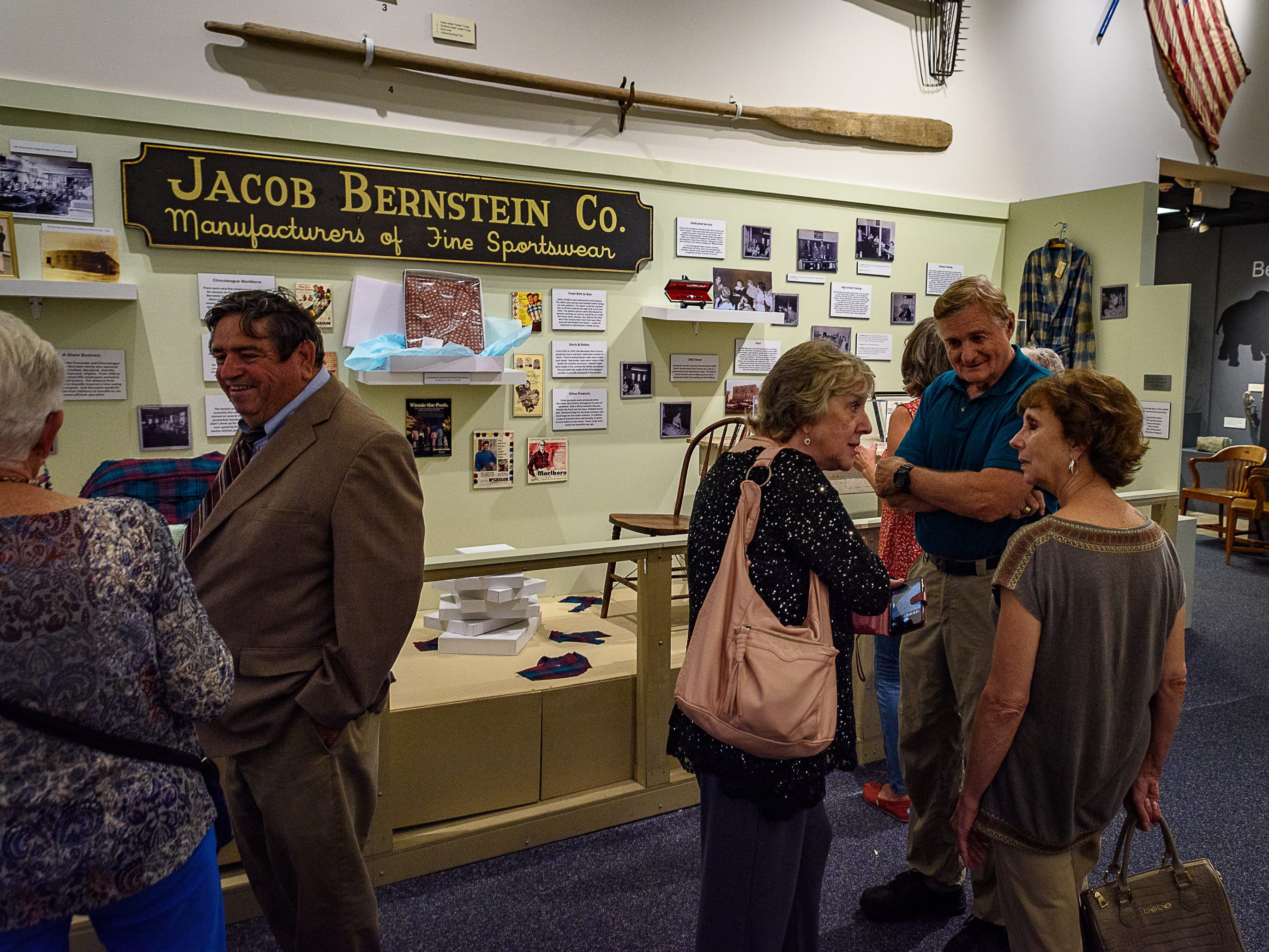 Members of the community attend the opening of three new exhibits at the Museum of Chincoteague on Wednesday.