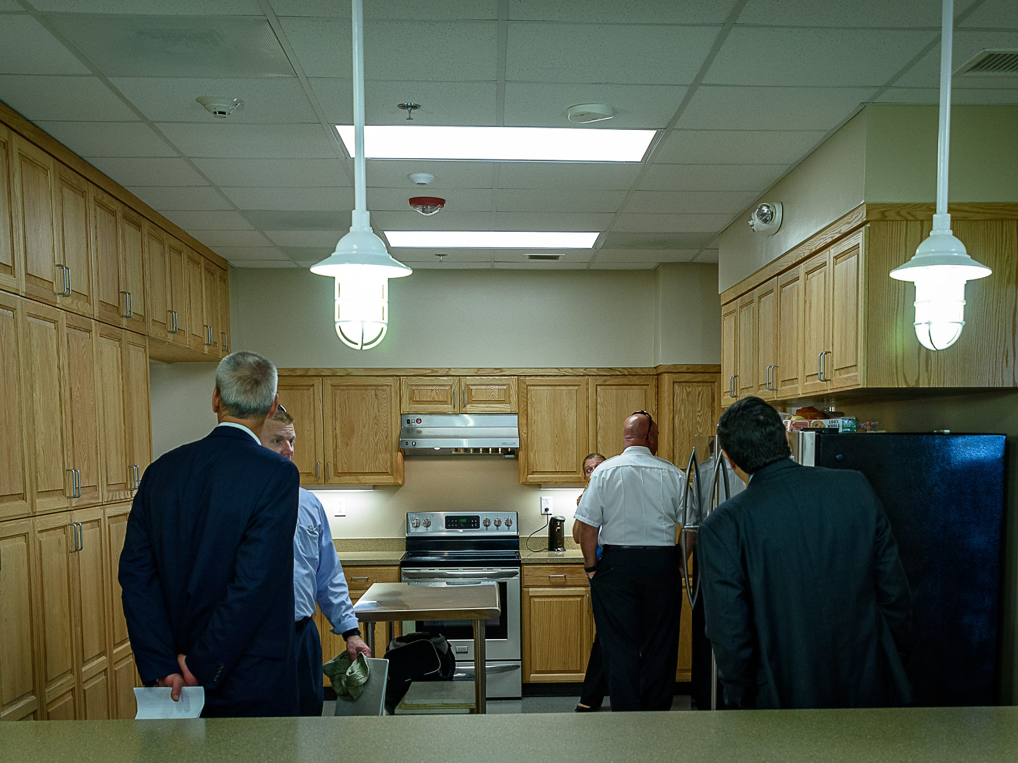 Guests look over the new kitchen at the Wallops fire station.