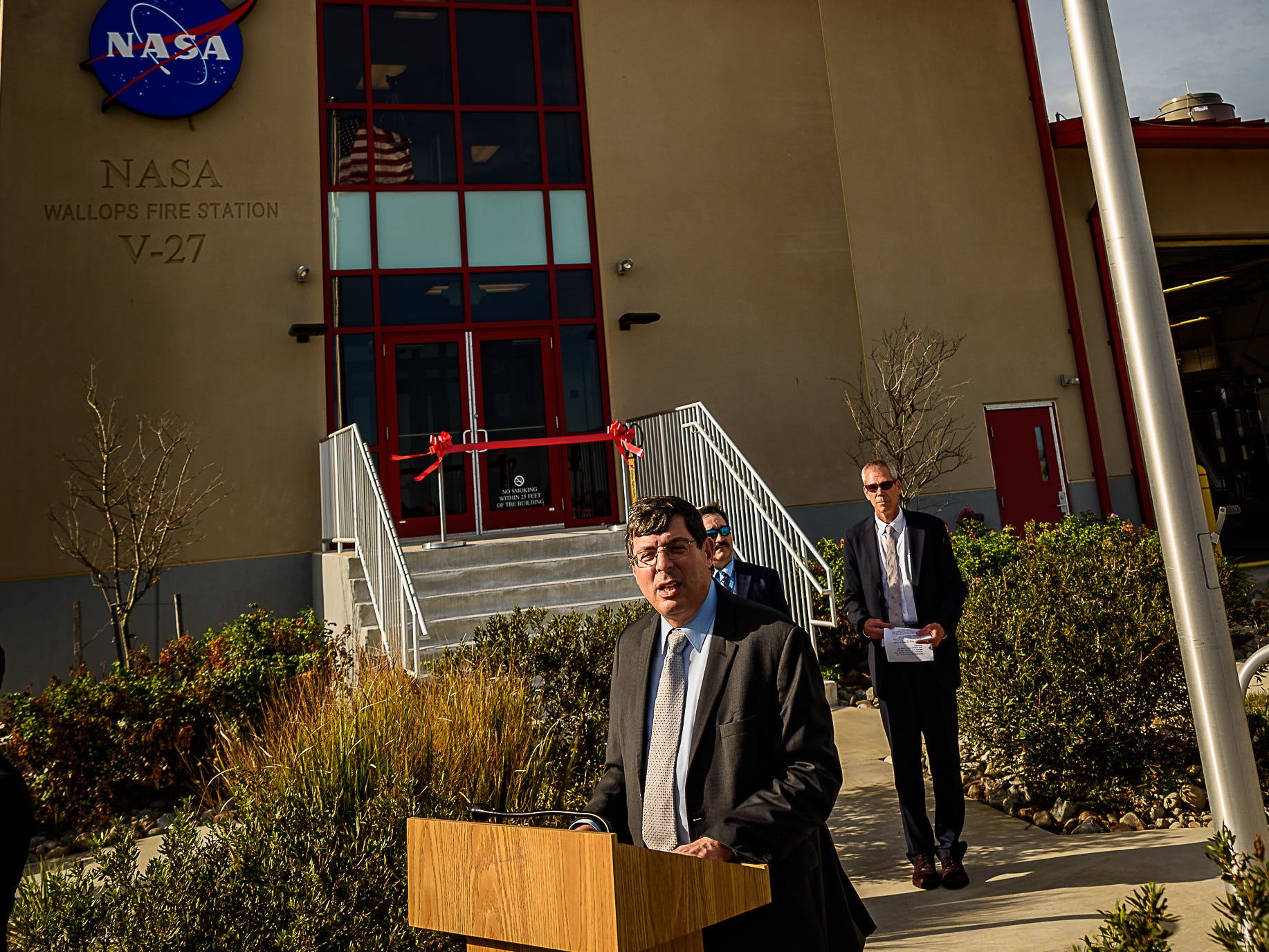 Goddard Center Director Chris Scolese speaks at the opening of the new facilities at Wallops Island as Bill Wrobel, director of Wallops Flight Facility, looks on.