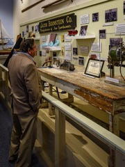 Nick Bernstein looks over the exhibit covering the clothing factory that his family owned on Delmarva.