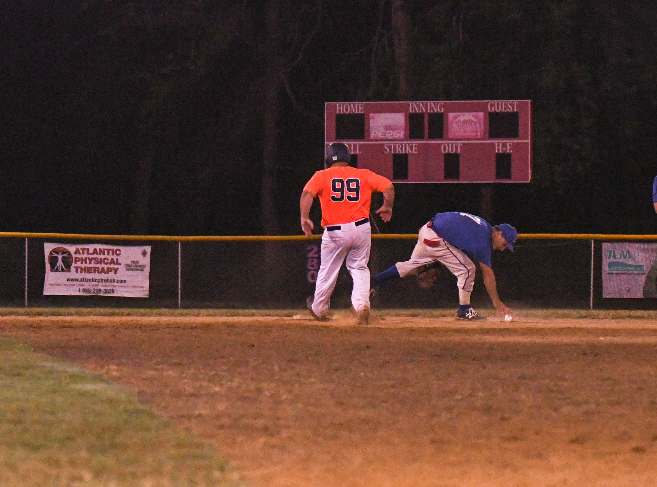 Otis Elzey makes it safely to second base during a game in the new Ty Cobb Senior Baseball League in Salisbury on Tuesday, Oct 9, 2018.