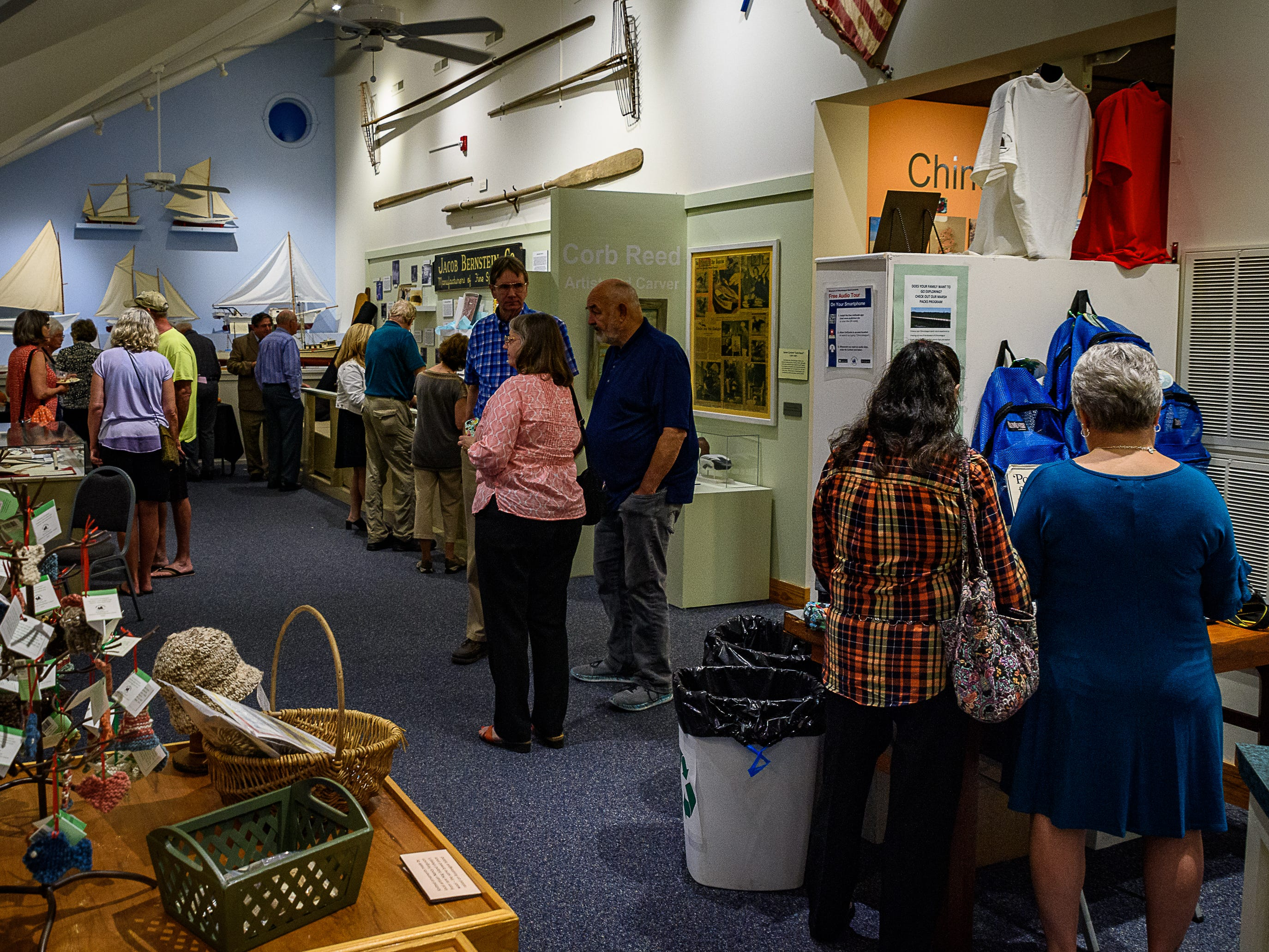 Island residents attend the opening of three new exhibits at the Museum Of Chincoteague.