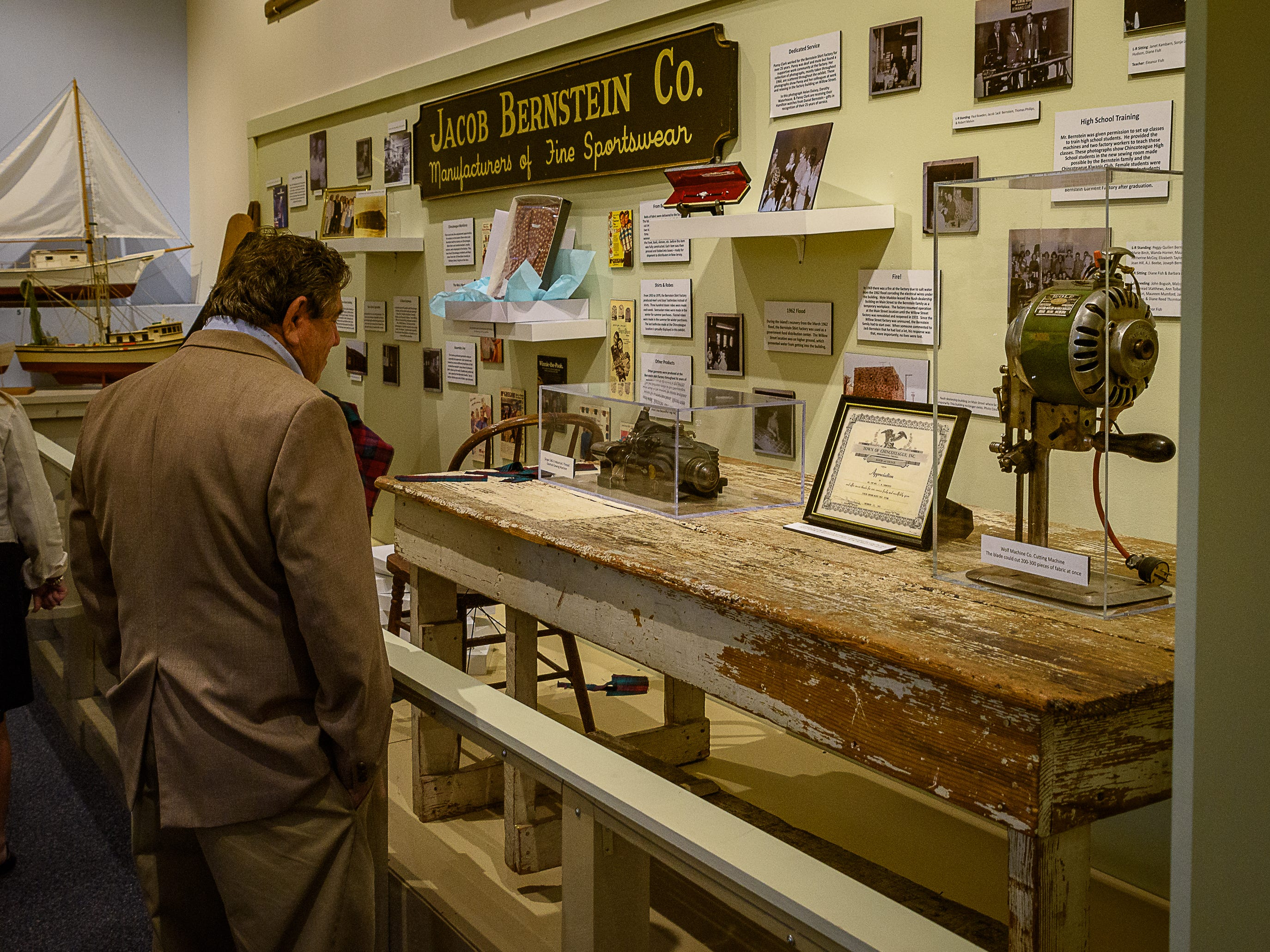 Nick Bernstein looks over the exhibit covering the factory that his family owned on Delmarva.