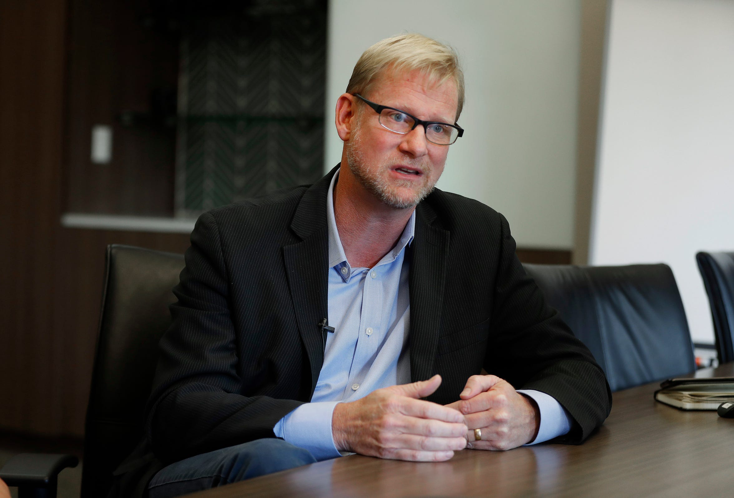 "In this Thursday, Aug. 23, 2018 photo, Chris Palusky, President and CEO of Bethany Christian Services, one of the nation's largest adoption agencies, explains their long term foster care program from their headquarters in Grand Rapids, Mich. ""We never want families to be separated,"" Palusky said. ""That's what we're about, is bringing families together."" (AP Photo/Paul Sancya)"