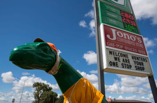 Gregory's Sinclair dinosaur statue shown on Tuesday, Sept. 25, 2018 in Gregory, S.D.