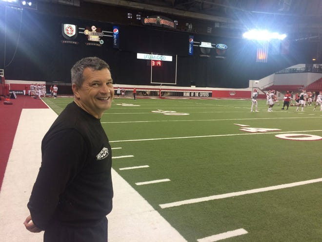 German football coach Martin Hanselmann watched South Dakota practice on Tuesday at the DakotaDome.